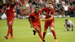 Toronto FC defender Ashtone Morgan (5) celebrates his goal with teammate Jonathan Osorio (21) during second half MLS Soccer action against the New York Red Bulls, in Toronto on Wednesday, July 17, 2019. THE CANADIAN PRESS/Nathan Denette