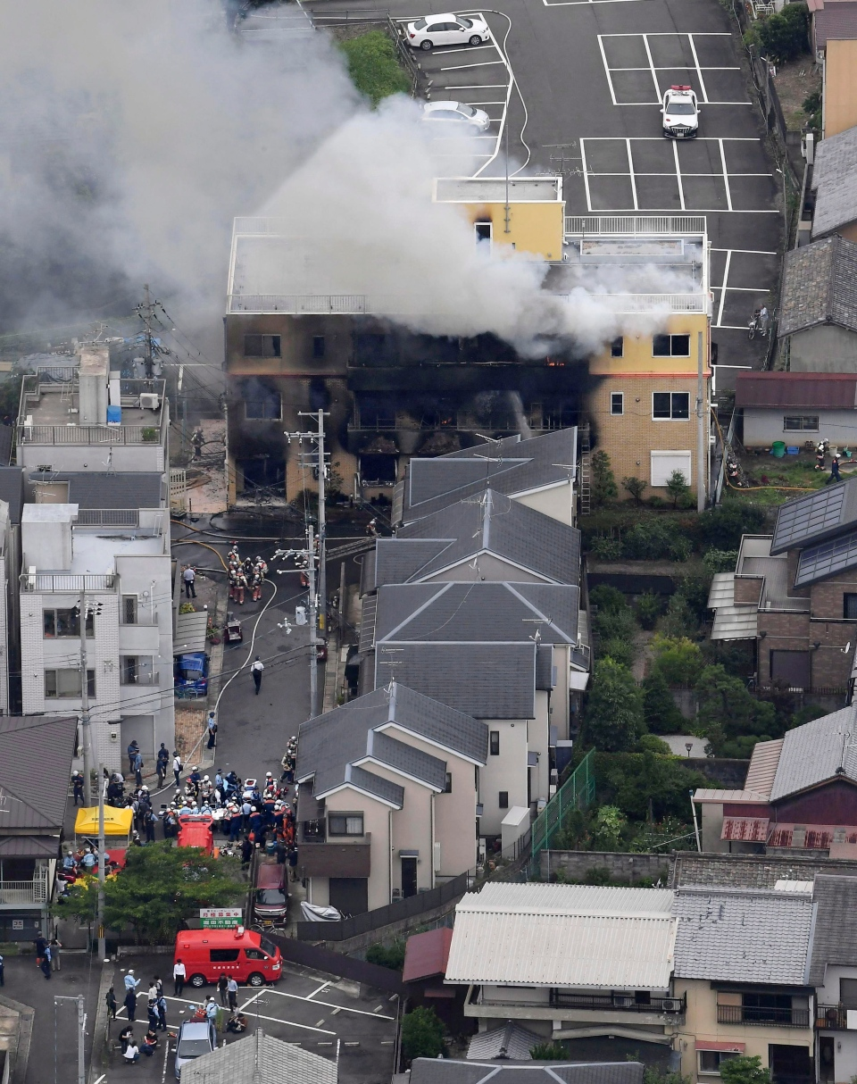 Smoke billows from a three-story building of Kyoto Animation in a fire in Kyoto, western Japan, Thursday, July 18, 2019. (Kyodo News via AP)