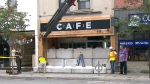 Concrete blocks are seen being placed outside of a CAFE dispensary on Bloor Street West.