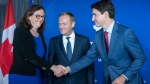 European Commissioner for Trade Cecilia Malmstrom shakes hands with Prime Minister Justin Trudeau as President of the European Council Donald Tusk looks on prior to a meeting in Montreal on Thursday, July 18, 2019. THE CANADIAN PRESS/Paul Chiasson