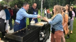 Jason Kenney serves pancakes at the annual K-Days Premier's Pancake Breakfast on July 18, 2019. (Galen McDougall/CTV News Edmonton)