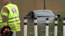 A car is submerged in floodwater on the Yellowhead on July 17, 2019. (Sean Amato/CTV News Edmonton)
