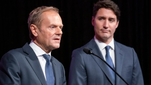 President of the European Council Donald Tusk gives opening remarks as Prime Minister Justin Trudeau looks on during a reception in Montreal on Wednesday, July 17, 2019. THE CANADIAN PRESS/Paul Chiasson