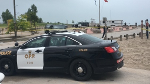OPP work along the Lake Erie shoreline in Port Stanley, Ont. on Thursday, July 18, 2019. (Kim Knight / CTV London)