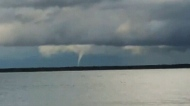Funnel clouds spotted around the Interlake