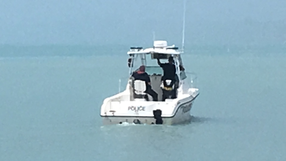 An OPP patrol boat is seen in the waters of Lake Erie, just off the shore of Port Stanley, Ont. on Thursday, July 18, 2019. (Jim Knight / CTV London)