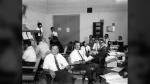 Owen Maynard, centre, with Tom Kelly of Grumman who built the lunar module. (NASA)