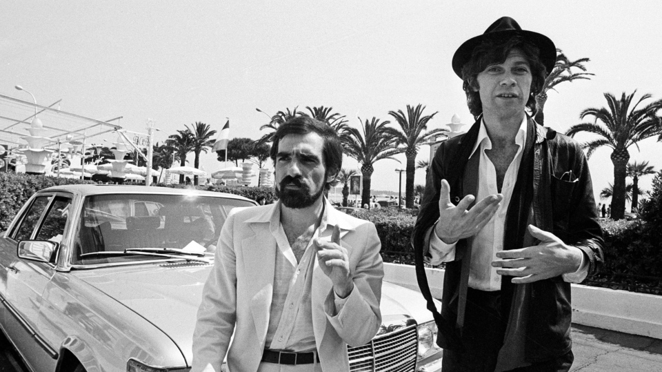 """Robbie Robertson, right, stands next to American director Martin Scorsese, left, before they presented the film """"Last Waltz,"""" a film about Robertson's band, at the 31st Cannes International Film Festival on May 29, 1978. THE CANADIAN PRESS/AP"""