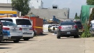 A rolled white car is seen at Acme FX, where a worker died on July 18, 2019. (Peter Muscat)