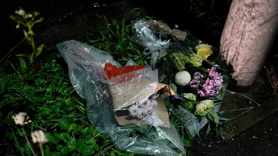 Flowers are placed near the Kyoto Animation building destroyed in an arson attack Thursday, July 18, 2019, in Kyoto, Japan. (AP / Jae C. Hong)