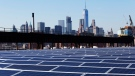 In this Feb. 14, 2017, file photo, a rooftop is covered with solar panels at the Brooklyn Navy Yard in New York. (AP Photo/Mark Lennihan, File)