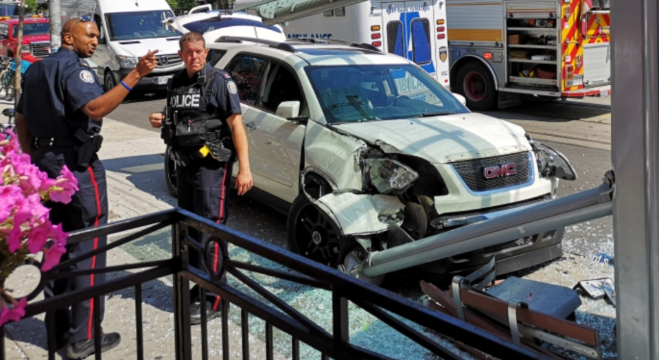 Toronto police investigate after a white SUV crashed into a bus shelter in Little Italy. (Courtesy: Francisco Pegado)