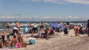 People fill the beach on a hot day at Wasaga Beach, Ont. (CTV News Barrie)