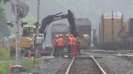Work is done on pavement repairs at the CP Rail tracks on Adelaide Street near Oxford Street in London, Ont. on Thursday, July 18, 2019. (Gerry Dewan / CTV London)
