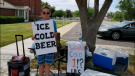 "Seth Parker is seen holding his ""Ice cold beer"" sign. (Brigham City Police Department/Facebook)"