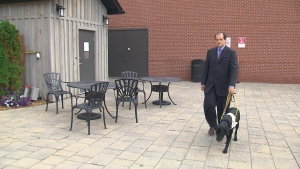 Ben Fulton is seen with his guide dog, Abbie, in this image from July 18, 2019.