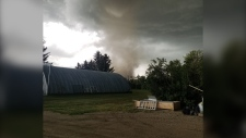 A tornado approximately 12 miles east of Carmangay, Alta on Thursday afternoon (image: Ryan Silsbe)