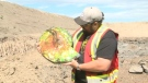Mine manager Mike Shideler with a piece of ammonite fossil like the one that was stolen from the mine Thursday