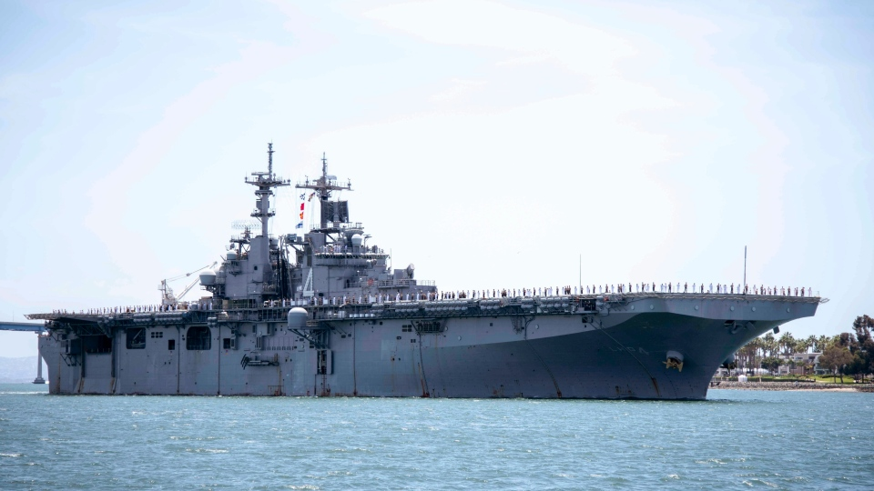 In this May 1, 2019, photo provided by the U.S. Navy, the amphibious assault ship USS Boxer (LHD 4) transits the San Diego Bay in San Diego, Calif. President Donald Trump says the USS Boxer destroyed an Iranian drone in the Strait of Hormuz amid heightened tensions between the two countries. (Mass Communication Specialist 2nd Class Jesse Monford/U.S. Navy via AP)