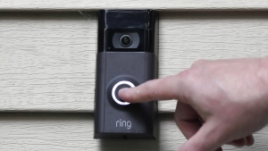 Ernie Field pushes the doorbell on his Ring doorbell camera at his home in Wolcott, Conn., on July 16, 2019. (Jessica Hill / AP)