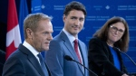 President of the European Council Donald Tusk responds to a question as Prime Minister Justin Trudeau and European Commissioner for Trade Cecilia Malmstrom listen in Montreal on July 18, 2019. (Paul Chiasson / THE CANADIAN PRESS)