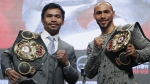 Manny Pacquiao, left, and Keith Thurman pose during a news conference, on July 17, 2019. (John Locher / AP)