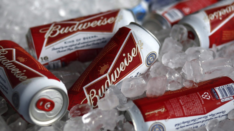 Budweiser beer cans are on ice at a concession stand. (Gene J. Puskar / AP)