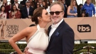 Amy Landecker, left, and Bradley Whitford arrive at the 22nd annual Screen Actors Guild Awards, on Jan. 30, 2016. (Jordan Strauss / Invision / AP)