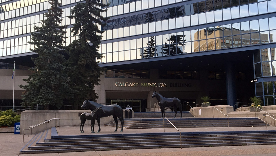 Calgary city council began weighing the budget cut package put forward by city staff.