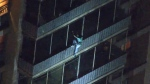 Man scales down building during fire