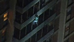 A man scales down a 19-storey building in West Philadelphia to escape a fire on Thursday, July 18. (WPVI-TV)