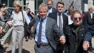 Dennis Oland and family members head from the Law Courts in Saint John, N.B., after he was found not guilty of murdering his father on Friday, July 19, 2019. (THE CANADIAN PRESS/Andrew Vaughan)