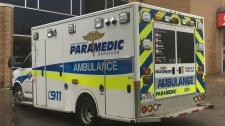 An ambulance outside of a Scotiabank