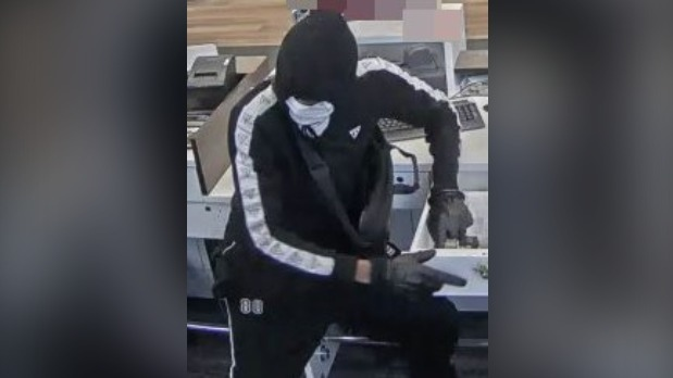 Disguised person in Cambridge bank
