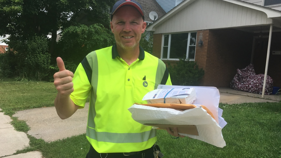 A postal worker is working in the heat in Windsor, Ont., on Friday, July 19, 2019. (Bob Bellacicco / CTV Windsor)