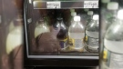 A rat is seen next to drinks in a 7-Eleven refrigerator in East Vancouver on Thursday, July 18, 2019. (Travis Williams)