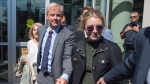 Dennis Oland and family members head from the Law Courts in Saint John, N.B., after he was found not guilty of murdering his father on Friday, July 19, 2019. Justice Terrence Morrison of the New Brunswick Court of Queen's Bench found Oland not guilty of second degree murder. Richard Oland was beaten to death on July 6, 2011. THE CANADIAN PRESS/Andrew Vaughan