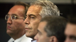 In this July 30, 2008, file photo, Jeffrey Epstein, center, appears in court in West Palm Beach, Fla. Under a 2008 plea deal, Epstein was allowed to spend most of his days at the office of his now-defunct Florida Science Foundation, which doled out research grants, rather than in the county jail, and now a Florida sheriff is launching an investigation into whether his department properly managed Epstein at that time. (Uma Sanghvi/Palm Beach Post via AP, File)