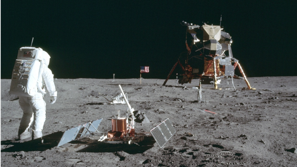 In this July 20, 1969 photo made available by NASA, astronaut Buzz Aldrin Jr. stands next to the Passive Seismic Experiment device on the surface of the the moon during the Apollo 11 mission. (Neil Armstrong / NASA via AP)