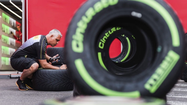 A technician checks tires at the Ferrari garage