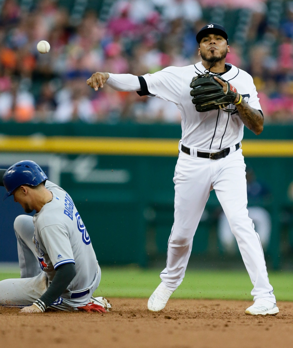 Detroit Tigers second baseman Harold Castro, right, turns the ball after getting a force-out against Toronto Blue Jays' Cavan Biggio (8) during the second inning of a baseball game, Friday, July 19, 2019, in Detroit. Blue Jays' Danny Jansen hit into the play and was safe at first. (AP Photo/Duane Burleson)