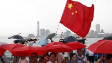 Pro-China supporters hold a counter-rally
