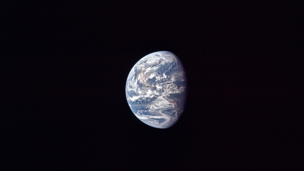 Earth as the Apollo 11 mission travels to the moon