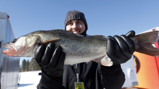 Josh Brown holds a walleye he caught