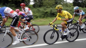 France's Julian Alaphilippe wearing the overall leader's yellow jersey, on July 20, 2019. (Christophe Ena / AP)