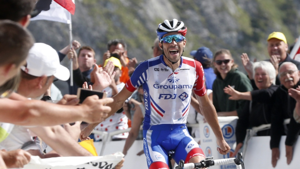 France's Thibaut Pinot celebrates as he crosses the finish line to win the fourteenth stage of the Tour de France, on July 20, 2019. (Thibault Camus / AP)