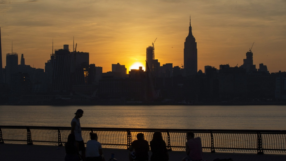 The sun rises over New York City