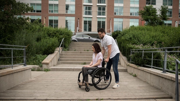 Survivors of the Danforth shooting attack Danielle Kane, left, and her partner Jerry Pinksen, leave Liberty Village Park in Toronto on Friday, July 12, 2019. (THE CANADIAN PRESS/ Tijana Martin)