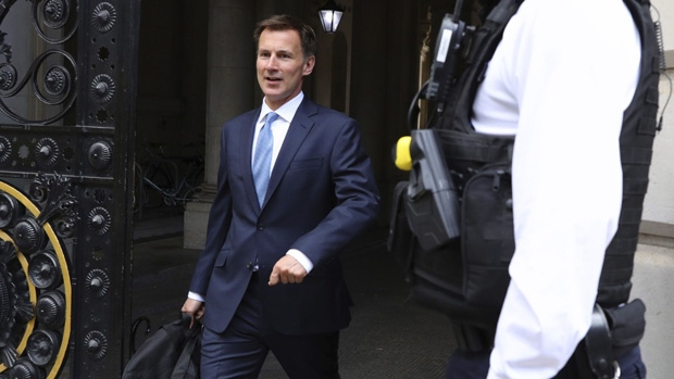 Britain's Foreign Secretary Jeremy Hunt leaves a meeting at 10 Downing Street, on July 20, 2019.  (Aaron Chown / PA via AP)