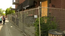 Marco's Resto-Bar in Ste-Anne-de-Bellevue was severely damaged by a fire in April and residents are wondering when the site might be cleaned up and fencing removed.